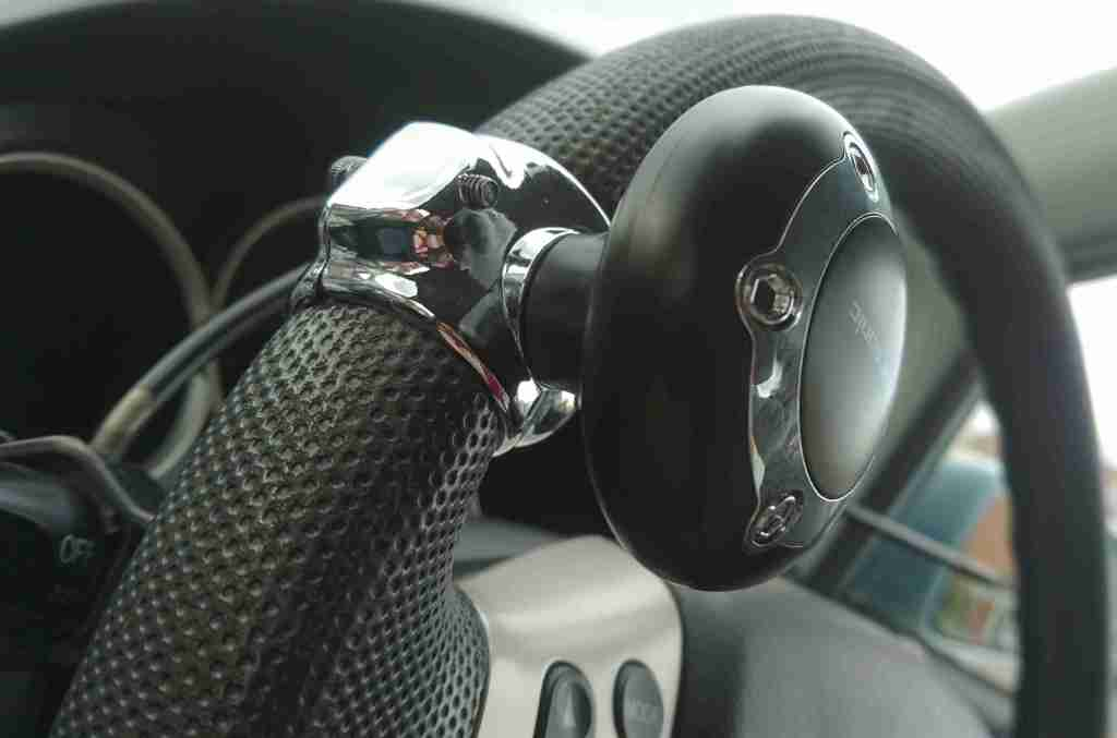a steering knob attached to the steering wheel. It is bolted on